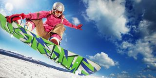 Woman snowboarder in air stock photos