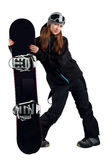 The woman snowboarder in the goggles. Snowboarder in a goggles holding his board Royalty Free Stock Photos