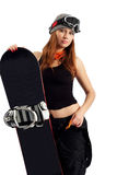The woman snowboarder in the goggles. Snowboarder in a goggles holding his board Royalty Free Stock Photography