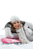 Woman snowboarder lie on board Stock Photo