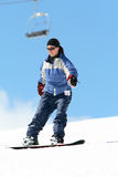 Woman snowboarding Royalty Free Stock Photo