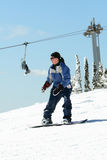 Woman snowboarding Stock Image