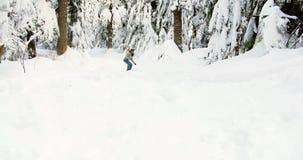Woman snowboarding on snowy mountain 4k. Woman snowboarding on snowy mountain slope 4k stock video