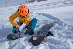 Woman snowboarding in winter mountains. One young woman ready for snowboarding in winter mountains Stock Image