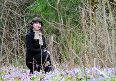 Woman among snowdrops Stock Photography