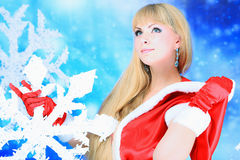 Woman with snowflake Royalty Free Stock Image