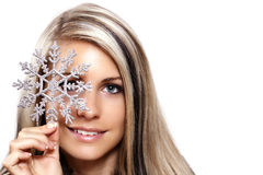 Woman with a snowflake. Sexy adult, studio photo Royalty Free Stock Images
