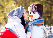 Woman with a snowman Stock Photography
