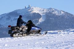 Woman on snowmobile royalty free stock images