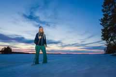 Woman snowshoeing by the lakeside Stock Photo