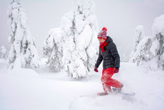 Woman snowshoeing Royalty Free Stock Photography