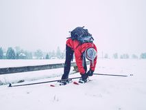 Woman snowshoeing in snow fall. Dark grey clouds. Are full of fresh snow. Winter sports royalty free stock images