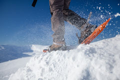 Woman snowshoeing in winter Carpathian mountains.  Royalty Free Stock Photography