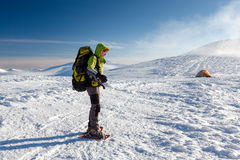 Woman snowshoeing in winter Carpathian mountains.  Royalty Free Stock Images