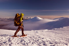 Woman snowshoeing in winter mountains. Woman snowshoeing in winter Carpathian mountains Royalty Free Stock Images