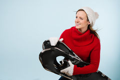 Woman and snowshoes Stock Images