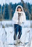 Woman and snowshoes Royalty Free Stock Photography