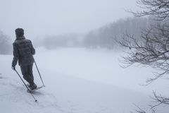 Woman with snowshoes in the fog. And snow Stock Photo
