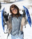 Woman with snowshoes in the mountains Stock Photos