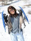 Woman with snowshoes in the mountains Royalty Free Stock Photos