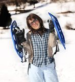 woman with snowshoes in the mountains stock photography