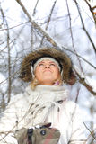 Woman in snowy forest Royalty Free Stock Photography