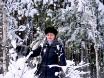 Woman in the snowy forest Stock Photos
