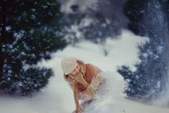Woman in a snowy forest Royalty Free Stock Photo