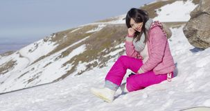 Woman on snowy mountain slope stock footage