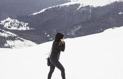 Woman snowy mountain Stock Photos