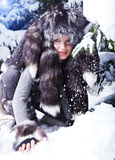 Woman in snowy winter outdoors Stock Photography