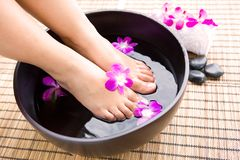 Woman Soaking Feet In Bowl Of Water Stock Images