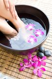 Woman Soaking Feet In Bowl Of Water Stock Photography