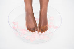 Woman soaking her foot in a bowl Royalty Free Stock Photo