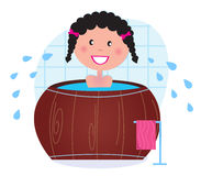 A woman soaking in whirlpool / cold barrel tub Royalty Free Stock Photography