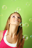 Woman with soap bubble Stock Image