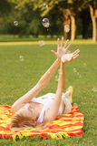 Woman and soap bubbles Royalty Free Stock Photos