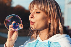 Woman with soap bubbles Royalty Free Stock Photography