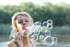 Woman and soap bubbles. There are  woman and soap bubbles Stock Photos