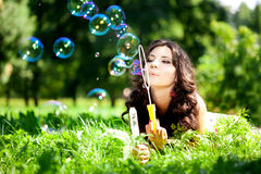 Woman and soap bubbles. In park Stock Photo