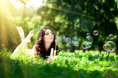 Woman and soap bubbles Royalty Free Stock Image