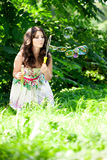 Woman and soap bubbles. In park Royalty Free Stock Photo