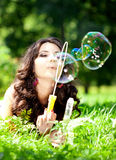 Woman and soap bubbles. In park Royalty Free Stock Photos