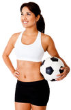 Woman with a soccer ball Stock Photography