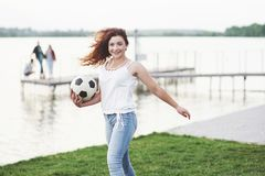 Woman with soccer ball royalty free stock image