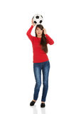 Woman with a soccer ball on head. Royalty Free Stock Photos