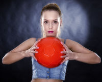 Woman with soccer ball isolated Royalty Free Stock Photography