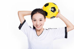 Woman with soccer ball Stock Images