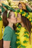 Woman soccer fans kissing Stock Photo