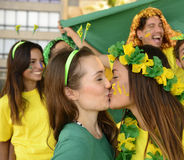 Woman soccer fans kissing Stock Photography
